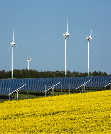 Wind turbines and solar panels in a rapeseed field Stock Photo - 13530938