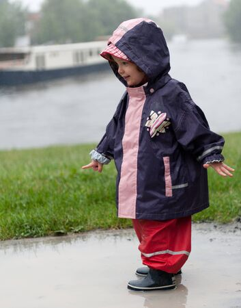 Little girl in rain photo
