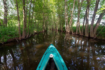 Paddle boat on canal in Mecklenburg photo