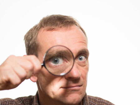 concave: Man looking through magnifying glass