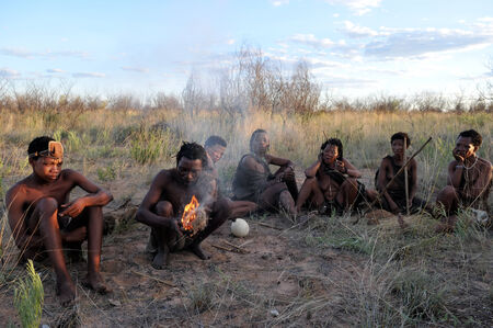 kalahari: Kalahari, Botswana - December 31, 2008: Bushmen in the Kalahari desert Botswana making fire