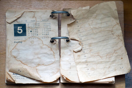 stapled: old calendar yellowed with spots Stock Photo