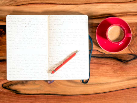 pitched: Notebook with espresso cup Stock Photo