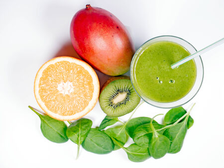 green smoothie with spinach, kiwi and orange photo