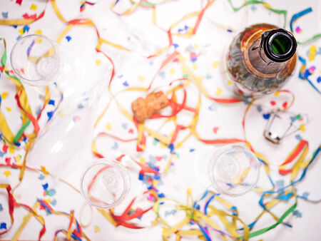 jahreswechsel: an open bottle of champagne with confetti