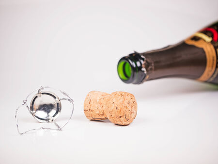 closure: lying champagne bottle with cork and closure