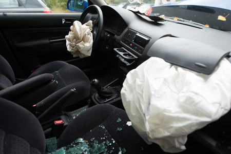 Detail of damaged car with deployed airbags