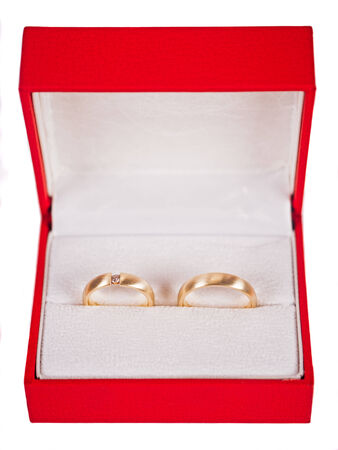 Wedding rings in red box on white background Stock Photo
