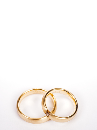 Two wedding rings on a white background