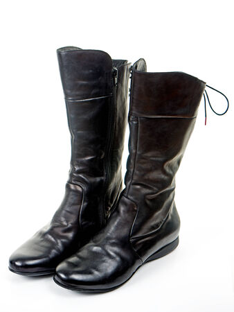 black leather boots for women on white background