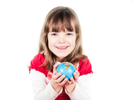 Hands of a child holding a globe Stock Photo