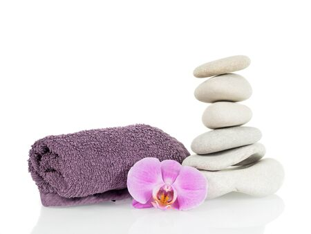 Stone tower with towel and orchid flower isolated
