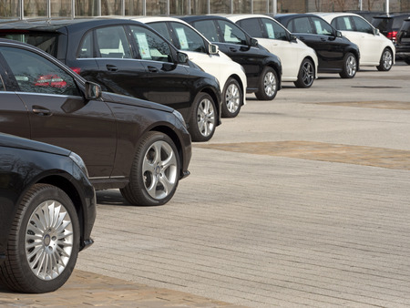 Cars for sale in a long row Stock Photo