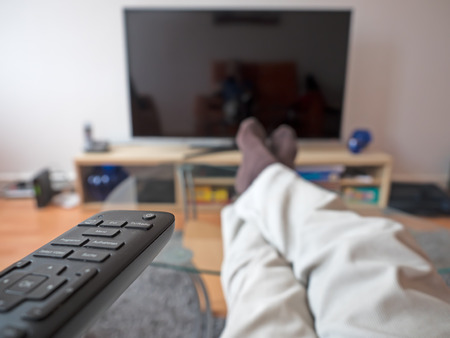 tv remote: man with TV