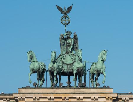 quadriga: Quadriga on the Brandenburg Gate in Berlin Stock Photo
