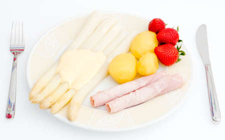 strawberrys: asparagus dish with strawberrys on a plate Stock Photo