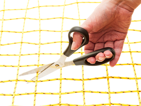 networked: Hand with scissors and yellow network on white background
