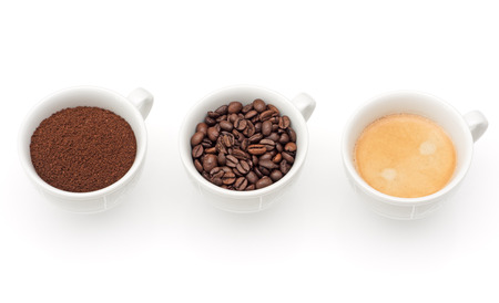 stimulate: Three cups with coffee, coffee beans and ground coffee