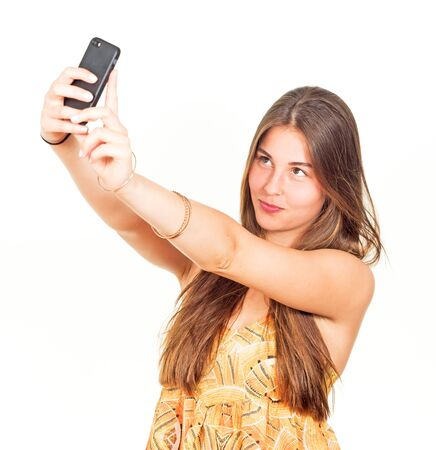 attractive young woman with long hair takes a selfie Stock Photo