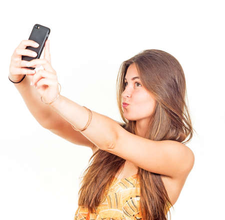 hair and beauty: attractive young woman with long hair takes a selfie Stock Photo