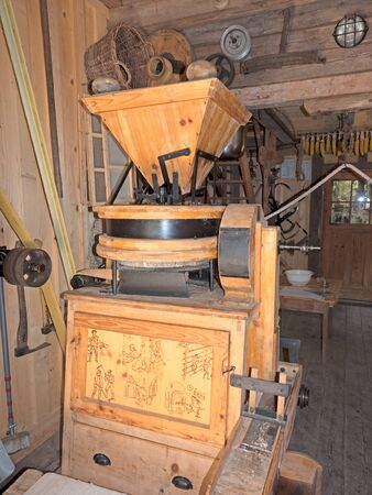 millstone: model of an old mill in a hut