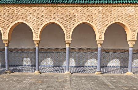 moorish: Arch with Moorish ornament in bright sunlight Stock Photo