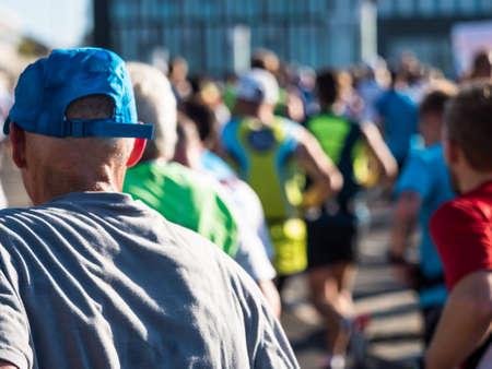 strenuous: Marathon runners in Berlin seen from backwards