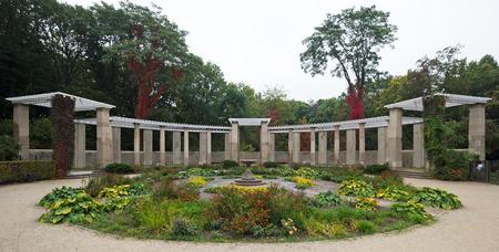 stone pergola in a park in autumn