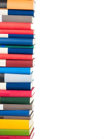 stacked books: many stacked Books isolated on white background Stock Photo