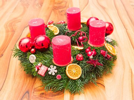 Advent wreath decorated on a wooden table