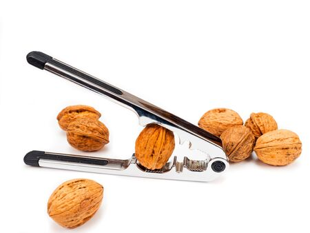 unsaturated: Nutcracker with walnuts cut out on white Stock Photo