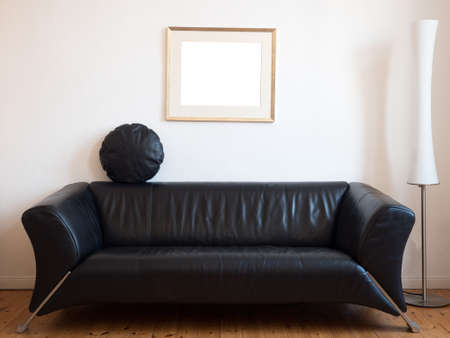 Black sofa with lamp in the living room