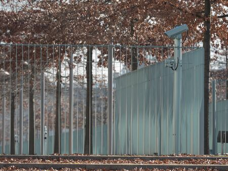 land locked: Metal fence around private property with video cameras