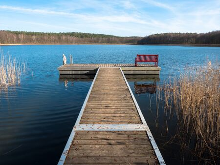 Dock with bench in a lake Stock Photo
