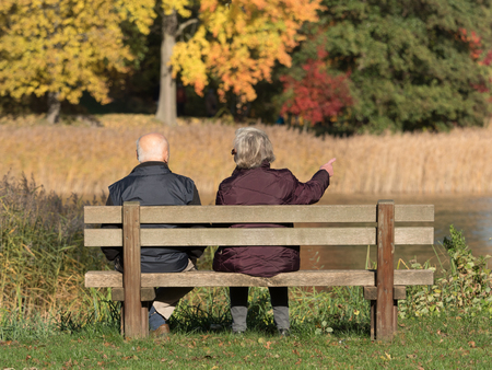 elder couple on a bench Stock Photo