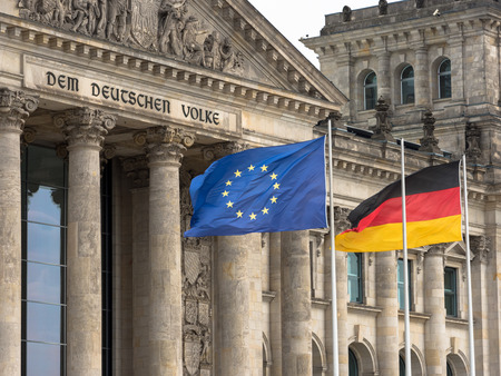 German parliament with flags Stock Photo