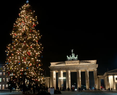 Christmas tree in front of Brandenburg Gate Berlin Stock Photo