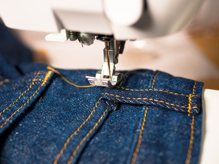 Jeans is sewn by sewing machine