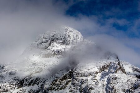 Summit in the mist of the clouds, Stunning landscape at Rila mountain in Bulgaria, Maliovica.