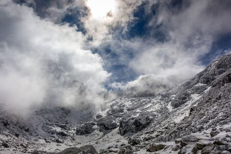 Beautiful winter view with dramatic clouds at the Rila mountain in Bulgaria, Maliovica. 写真素材