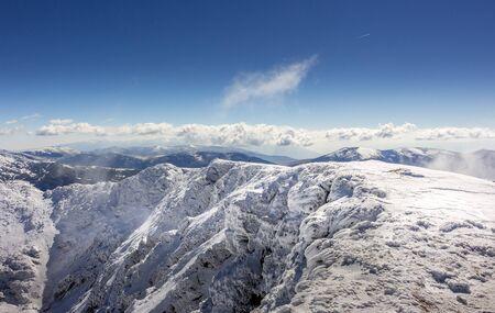 Beautiful winter landscape in the clouds at the Rila mountain in Bulgaria, Maliovica. 写真素材 - 134822867