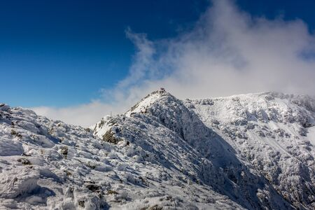 Hiking to the Maliovica summit after a cold winter storm at the Rila mountain in Bulgaria, Maliovica. 写真素材 - 134823034