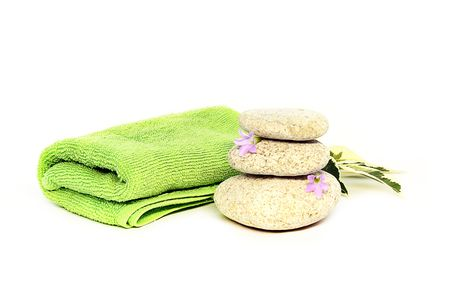 green towel and stones