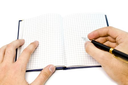 hand writing on a notebook photo