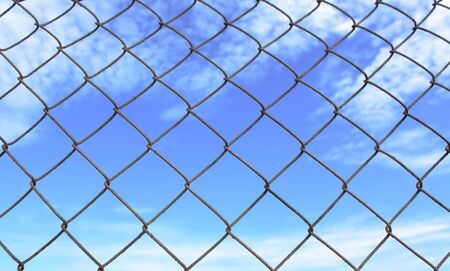 Metal grate on the sky background photo