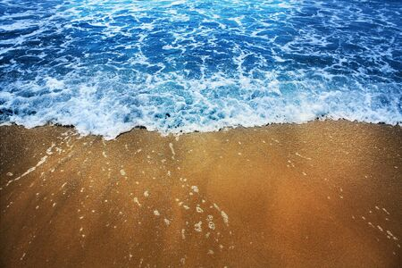 Golden sand and blue sea photo