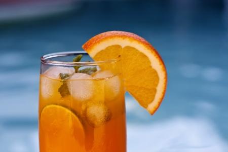 Orange juice around a swimming pool