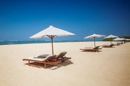 beach umbrella: Many sitting on the beach