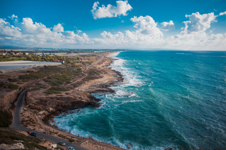 The rocky coastline, blue sea Stock Photo