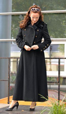red head woman: Run Way Model: Beautiful Red Head Woman in full length coat Stock Photo